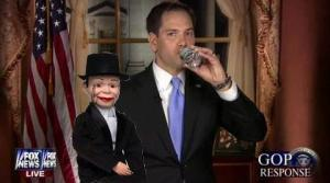 One of them is a dummy and the other is Charlie McCarthy.