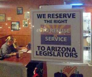 A real sign at a pizza joint in AZ